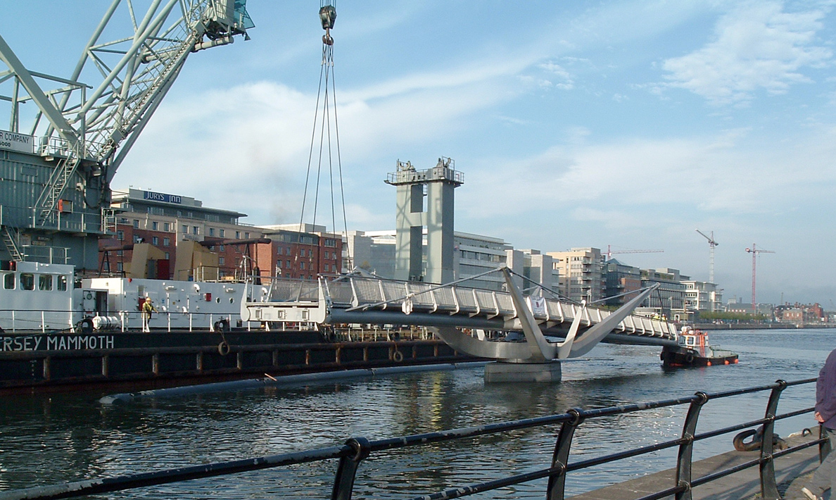 Installation of double leaf pedestrian swing bridge River Liffey, Custom House Quay | Dublin