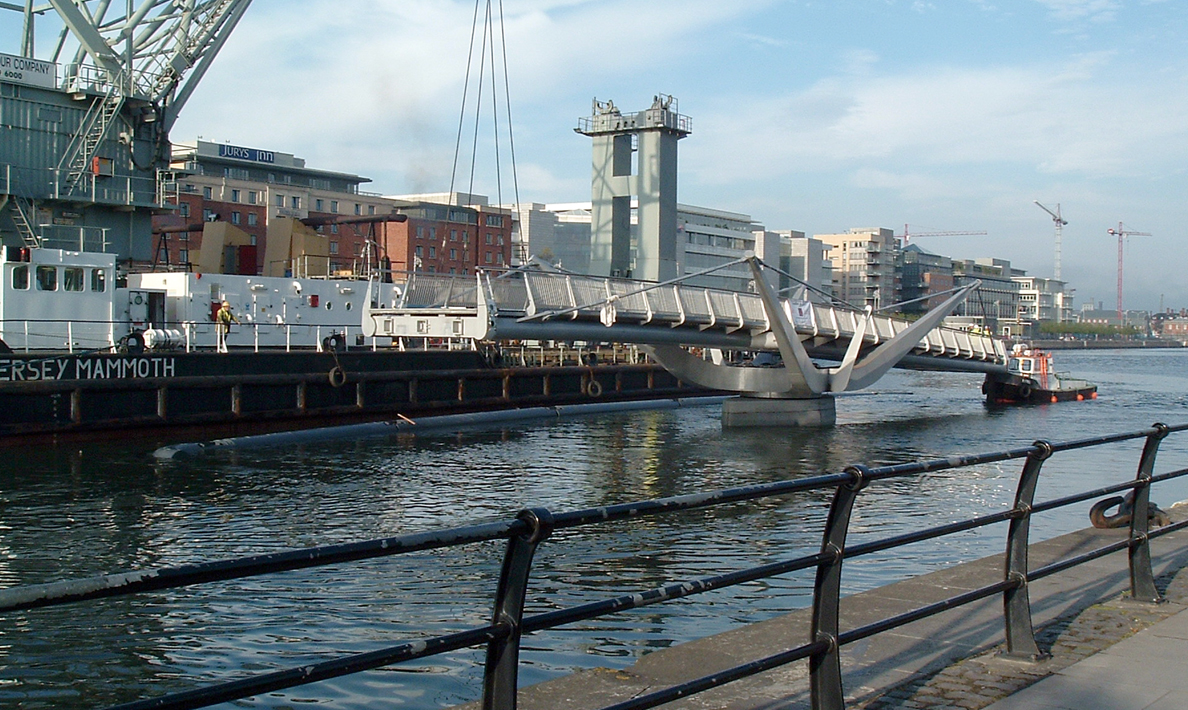 Installation of double leaf pedestrian swing bridge, River Liffey, Custom House Quay | Dublin